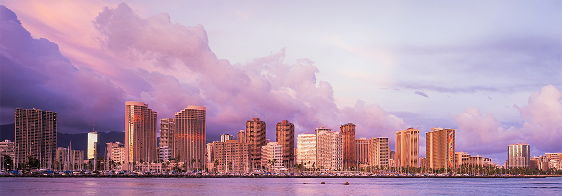Hawaii skyline with water front and sunset colors.